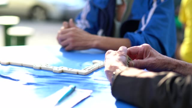 close-up of senior hands playing domino game - dominoes stock videos & royalty-free footage