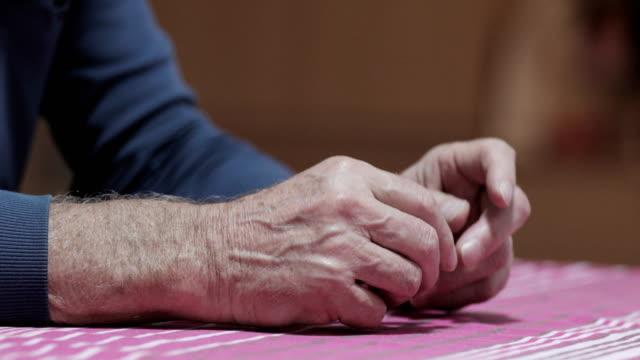 nahaufnahme von senior man with parkinson es disease - shaking stock-videos und b-roll-filmmaterial
