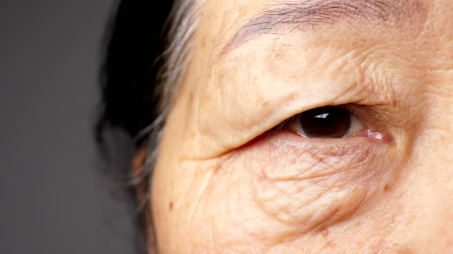 close-up of senior woman's eye - close to stock videos & royalty-free footage