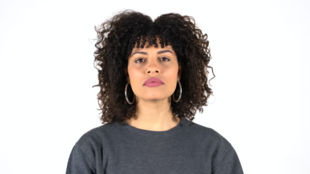 close-up of serious woman with curly hair - blank expression stock videos & royalty-free footage