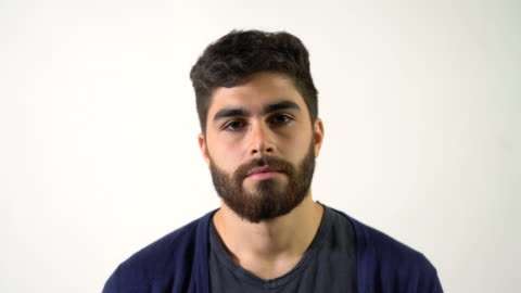 close-up of serious young man with beard - white background stock videos & royalty-free footage