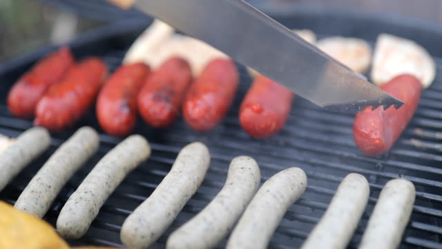 close-up of serving tongs arranging sausages - sausage stock videos & royalty-free footage