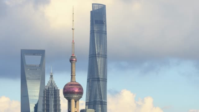 4k: close-up of shanghai skyscraper at time lapse, china - day to sunset stock videos & royalty-free footage