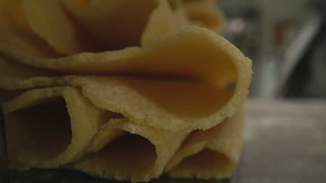 close-up of sheets of fresh pasta coming from pasta machine - man and machine stock videos & royalty-free footage