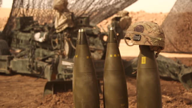stockvideo's en b-roll-footage met closeup of shells at a us army base in iraq with a personal message left on one of them for islamic state fighters - wapen apparatuur