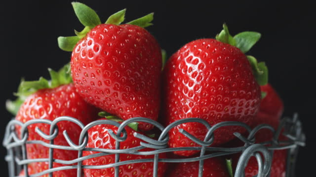 close-up of shiny, red organic strawberries in wire basket - juicy stock videos & royalty-free footage