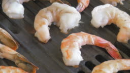 Closeup of Shrimp Cooking on a Grill in 4k