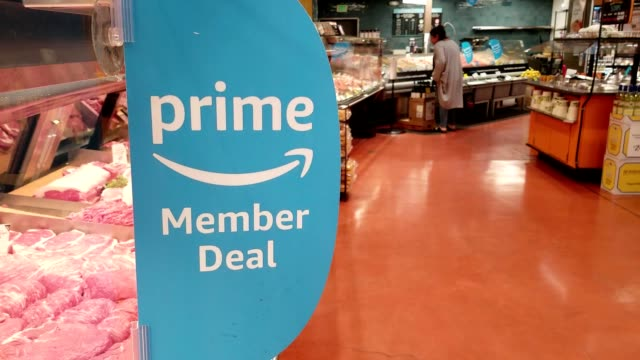 closeup of sign announcing amazon prime discounts at whole foods market following the upscale grocery chain's acquisition by amazoncom san ramon... - whole foods market stock videos and b-roll footage