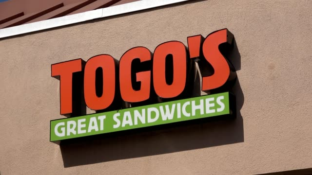 Closeup of sign with logo on facade of regional sandwich shop TOGO's in Dublin California May 18 2018