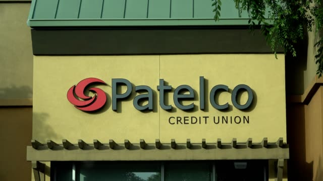 closeup of sign with logo on facade of the patelco credit union a major regional credit union in dublin california may 21 2018 - credit union stock videos & royalty-free footage