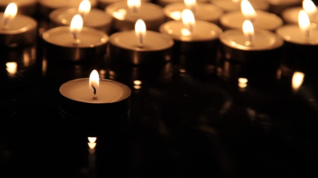 close-up of small burning candles - candle stock videos & royalty-free footage