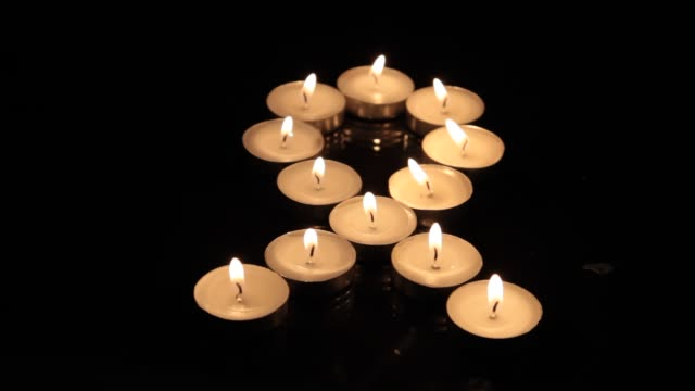 close-up of small burning candles - aids stock videos & royalty-free footage