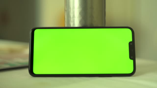 close-up of smartphone chroma key green screen smartphone in office - male likeness stock videos & royalty-free footage