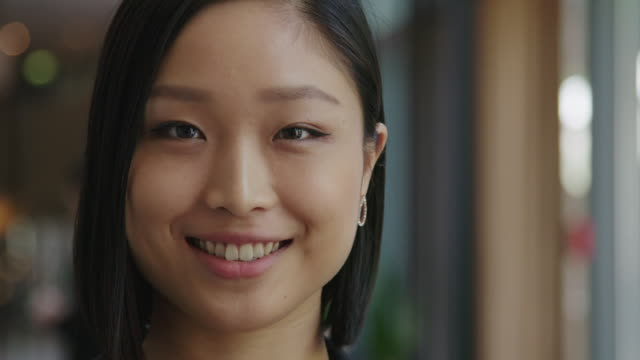 close-up of smiling businesswoman during seminar - japanese ethnicity stock videos & royalty-free footage