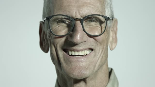 close-up of smiling senior male wearing eyeglasses - primissimo piano video stock e b–roll