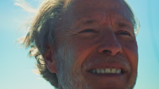 close-up of smiling senior man looking away - retirement stock videos & royalty-free footage