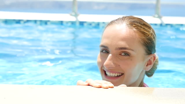 Close-up of smiling woman in pool