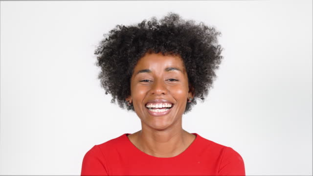 close-up of smiling young woman in red casual - white background stock videos & royalty-free footage
