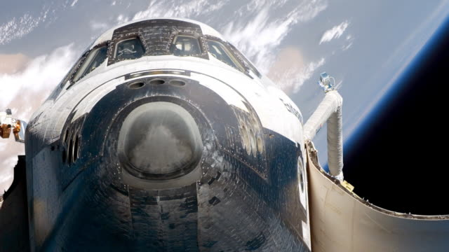 close-up of space satellite with earth in background - space shuttle stock videos & royalty-free footage
