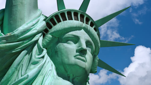 T/L Close-up of Statue of Liberty with clouds rolling in the background   / New York, New York, USA
