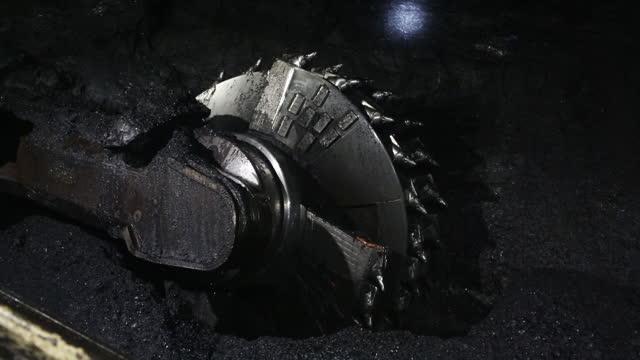 close-up of steel cogwheel in osinnikovskaya coal mine, operated by raspadskaya pjsc, in osinniki, kemerovo oblast, russia, on thursday, february 4,... - cog stock videos & royalty-free footage