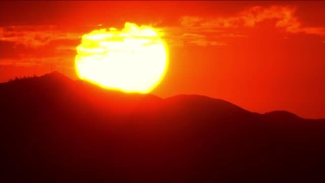 CloseUp of Sun Rising Behind San Fernando Valley on September 09 2013 in Sylmar California
