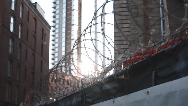 Closeup of sunlight peeking through barbed wire