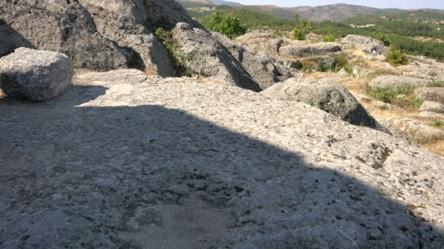close-up of tatul surface tomb and sanctuary in eastern rhodope mountains, bulgaria - surrounding wall stock-videos und b-roll-filmmaterial