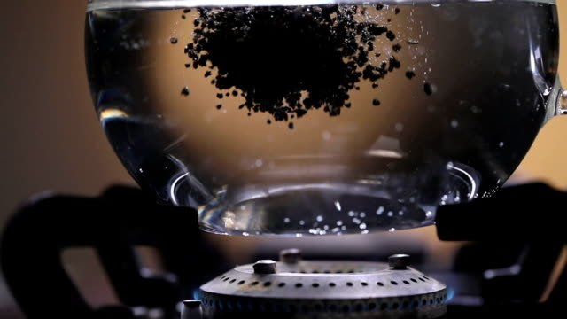 Close-up of tea boiling on stove