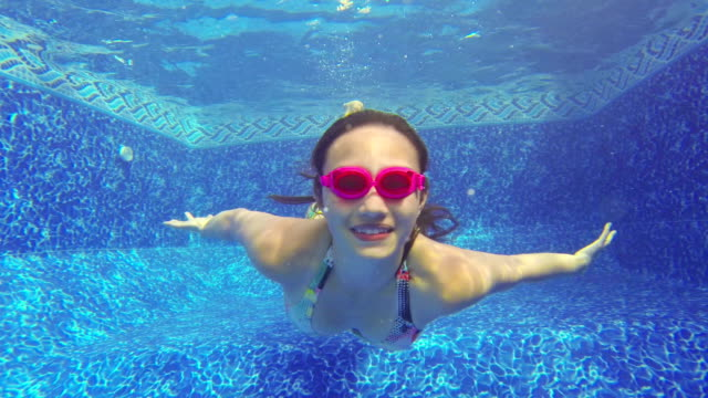 close-up of teenage girl blowing bubbles swimming  underwater - swimming goggles stock videos & royalty-free footage