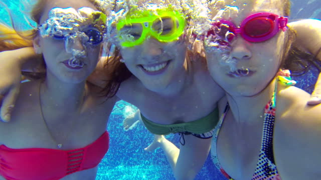 close-up of teenage girls blowing bubbles underwater - swimming goggles stock videos & royalty-free footage