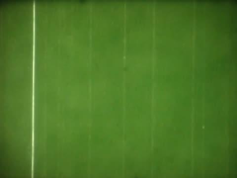 vidéos et rushes de close-up of text and dust on a green film leader - lettre majuscule