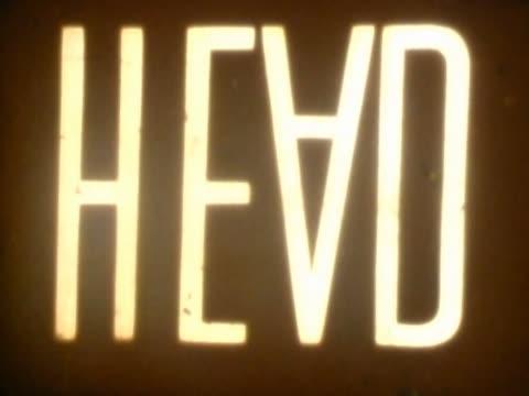 vidéos et rushes de close-up of text on a film leader - lettre majuscule