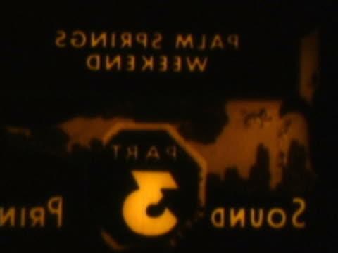 stockvideo's en b-roll-footage met close-up of text on a film leader - achterstevoren