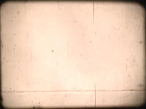 close-up of text on a film leader - abblenden stock-videos und b-roll-filmmaterial