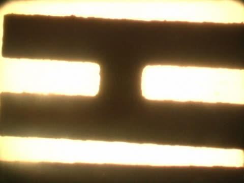 close-up of text scrolling on a film leader - nedtoning bildbanksvideor och videomaterial från bakom kulisserna