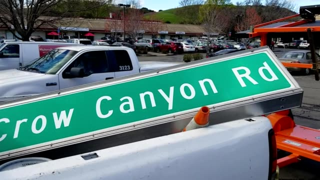 closeup of the back of a pickup truck with a large road sign for crow canyon road in san ramon california part of the installation of a new road sign... - directional sign stock videos & royalty-free footage