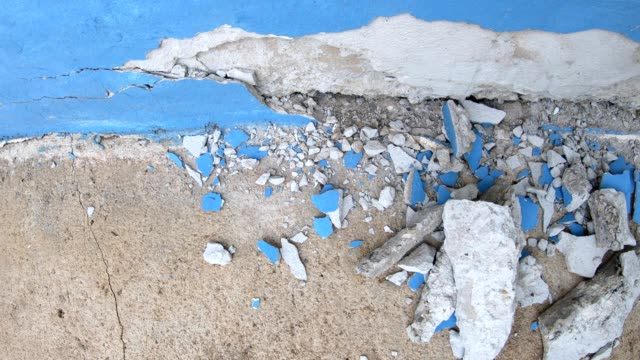 close-up of the broken concrete corner of the room. - weathered stock videos & royalty-free footage