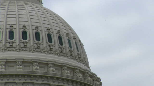 close-up of the dome of the us capitol building and the flag of the usa - identity politics stock videos & royalty-free footage