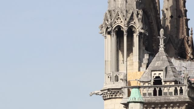 closeup of the east facade of the cathedral / a fire broke out on monday afternoon and quickly spread across the building / causing the famous spire... - spire stock videos and b-roll footage