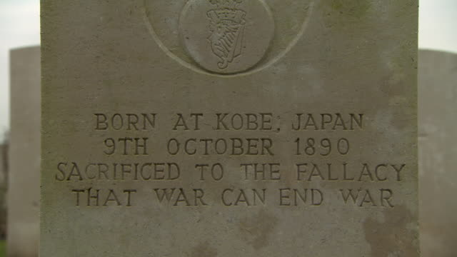 closeup of the epitaph of a wwi gravestone which criticises war reading 'sacrificed to the fallacy that war can end war' tyne cot cemetery belgium... - cot stock videos & royalty-free footage