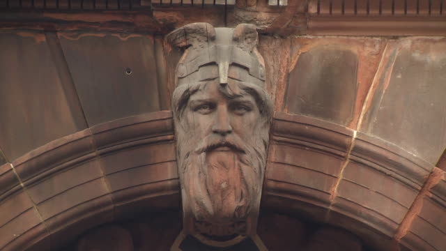 close-up of the face of a viking rendered in stone over the entrance to what is now the fairfield heritage centre, where formerly offices to a shipyard were located, govan, glasgow, scotland. - british culture stock videos & royalty-free footage