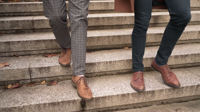 a close-up of the feet and shoes of two smartly dressed men walking together - fashionable stock videos & royalty-free footage