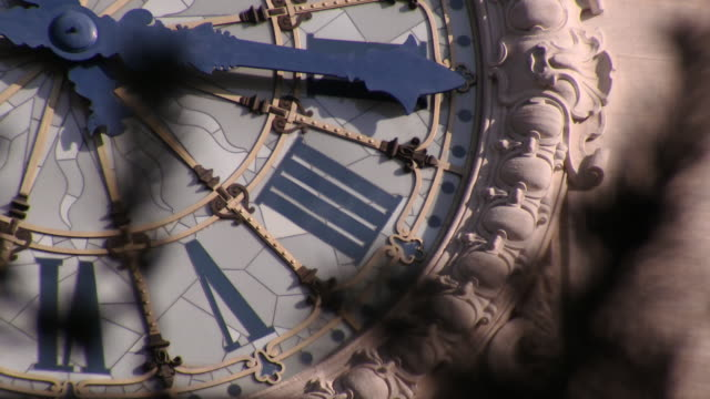 close-up of the historical clock tower face at paris gare de lyon station - clock tower stock videos & royalty-free footage