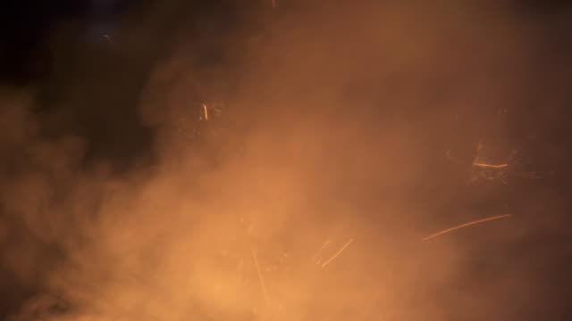 Close-up of the smoke and sparks coming off a fire in an iron foundry, UK.