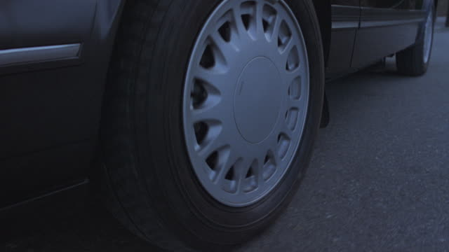 close-up of the tire of a moving car. - tyre stock videos & royalty-free footage