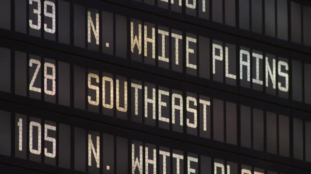 Close-Up of the White Plains Departure Board in Grand Central Terminal in Manhattan