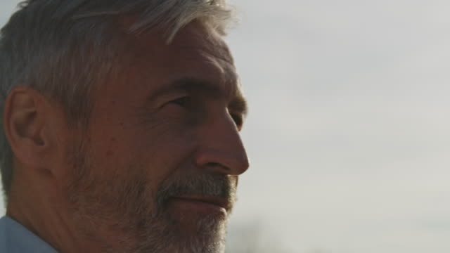 close-up of thoughtful man looking away in summer - mature men stock videos & royalty-free footage