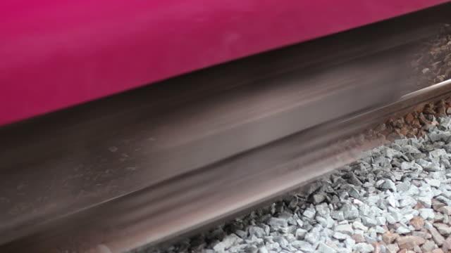close-up of train passing through rails. - vicino video stock e b–roll