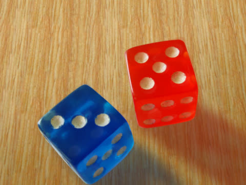 close-up of two dice rolling on a table - two objects stock videos & royalty-free footage